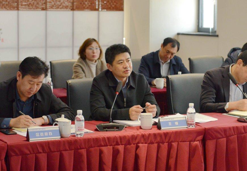 崂山区委副书记、区长王锋到海易胜博官方网站科技集团调研